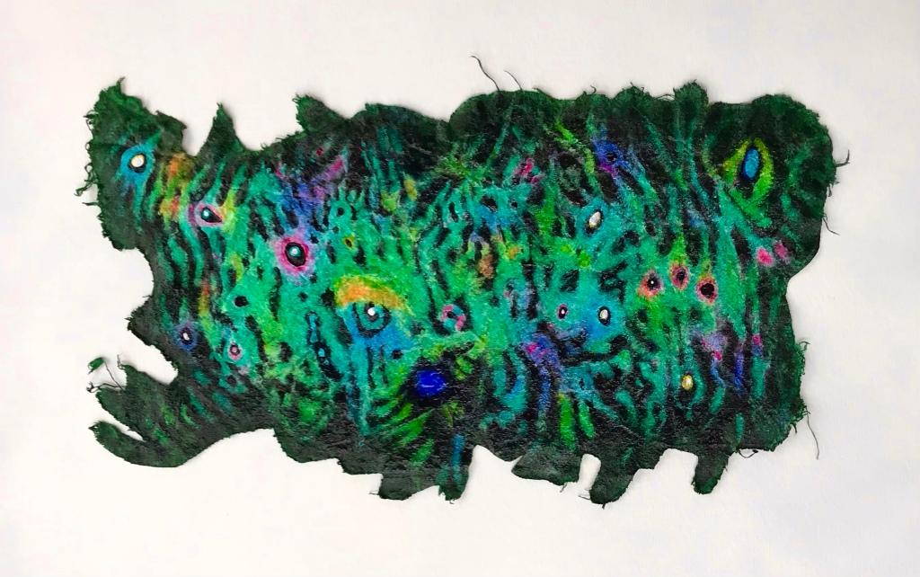 Full view of a colorful abstract painting on a scrap of drop cloth by MJ Seal that resembles some peculiar sea creature with numerous eyespots