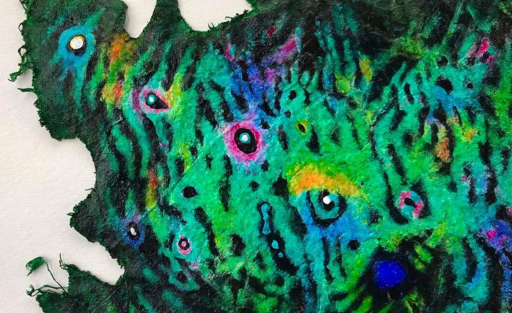 Close up detail of a colorful abstract painting on a scrap of drop cloth by MJ Seal that resembles some peculiar sea creature with numerous eyespots