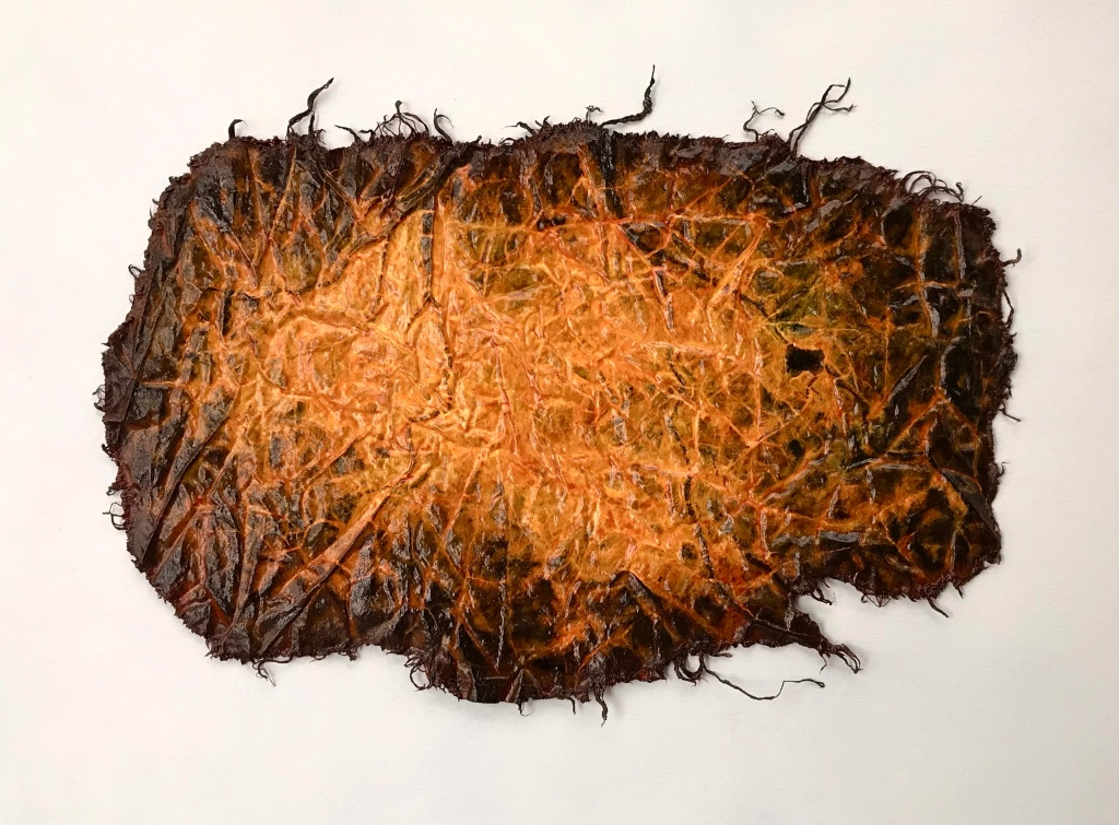 full view of an original painting by MJ Seal that resembles a cross between an aerial view of a city at night and a bright orange and black deep sea creature